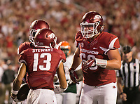 Hawgs Illustrated/BEN GOFF <br /> Ty Clary (66), Arkansas offensive lineman, congratulates Deon Stewart, Arkansas wide receiver, after Stewart scored a touchdown against Florida A&M Thursday, Aug. 31, 2017, during the game at War Memorial Stadium in Little Rock.