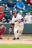 Micah Johnson (3) of the Winston-Salem Dash follows through on his swing against the Potomac Nationals at BB&T Ballpark on July 8, 2013 in Winston-Salem, North Carolina.  The Dash defeated the Nationals 12-9.  (Brian Westerholt/Four Seam Images)
