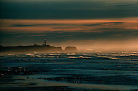 LIGHTHOUSE<br /> Lighthouse on the Oregon Coast at sunset<br /> Lighthouse at dusk with searchlight visible.