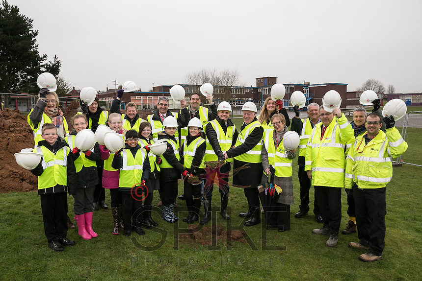 Turning the first sod at the official ground breaking ceremony for the new Flying High Academy are pupils, staff, dignataries and Kier Construction staff