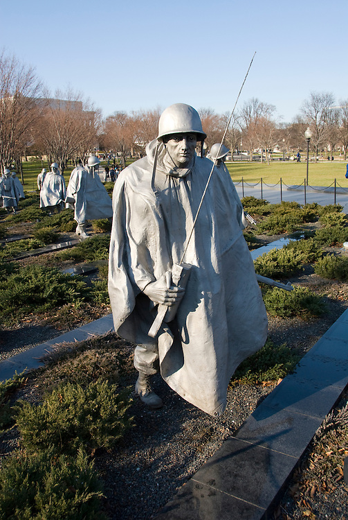 Washington DC; USA: The Korean War Veterans Memorial.  The statues of a platoon of soldiers marches warily across a field..Photo copyright Lee Foster Photo # 9-washdc76133