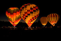 Hot air balloons rise into the night sky during the annual Carolina BalloonFest, held each fall in Statesville, NC. Photos were taken at the October 2008 event.