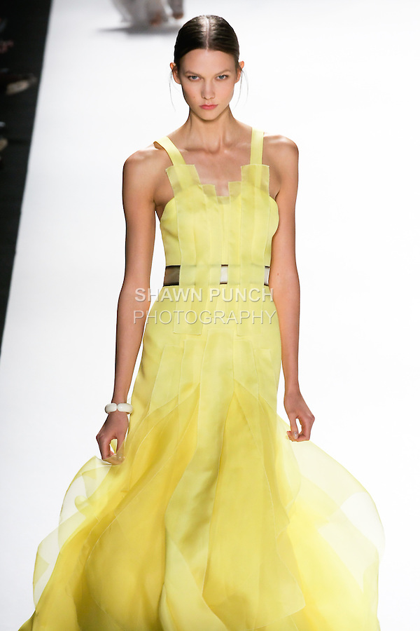 Karlie Kloss walks the runway in a canary yellow silk gazar gown with silk organza band qpplique for the Carolina Herrera Spring 2012 fashion show, during Mercedes-Benz Fashion Week Spring 2012.
