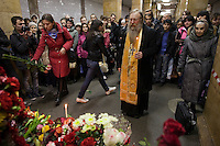 Moscow, Russia, 30/03/2010..A Russian Orthodox priest lights candles and prays at a makeshift shrine on the spot inside Park Kultury metro station where a female suicide bomber blew herself up the previous day. At least 39 people were killed and 80 injured in the double blasts at Moscow metro stations during the morning rush hour.