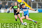 David Clifford of IT Tralee about to pull the trigger as Ronan Ryan of Carlow IT bears down on him, in the Sigerson Cup R1 football game in Austin Stack Park on Sunday.