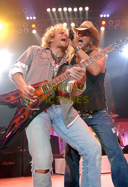 "C C DEVILLE & BRET MICHAELS of Poison.Singer Bret Michaels is in critical condition suffering from a brain hemorrhage, his publicist Joann Mignano said. Michaels the former Poison frontman was rushed to intensive care late Thursday after a severe headache. Doctors discovered bleeding at the base of his brain stem. The 47-year-old glam-rock reality TV star had an emergency appendectomy at a private care facility for diabetics last week after complaining of stomach pains before he was scheduled to perform in San Antonio, Texas. Michaels is currently a contestant on the third season of Donald Trump's NBC competitive reality show, ""The Celebrity Apprentice."" Trump said in a statement Friday that he was ""deeply saddened"" to hear of Michaels' condition - USA - 23rd April 2010..FILE PHOTO: 30th August 2007- Fayetteville, North Carolina - Singer Bret Michaels and Guitarist C.C. Deville of the band Poison performs at the Crown Coliseum. .music concert gig on stage half length .band guitar ripped jeans cowboy hat singing microphone .CAP/ADM/MOO.© Moose/AdMedia/Capital Pictures."