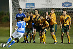 27 March 2004: Diego Gutierrez (7) of the Wizards takes a free kick in the first half. The players in the wall are (l to r) Diego Walsh (Wizards), Ricky Lewis (2), Jovan Kirovski, Arturo Torres (21), Andreas Herzog (10), and Sasha Victorine (11). Los Angeles Galaxy defeated the Kansas City Wizards 1-0 at SAS Stadium in Cary, NC in the final preseason game for both Major League Soccer teams as part of the Cary Pro Kickoff Invitational tournament..