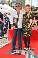 LOS ANGELES, CA. August 22, 2018: Simon Cowell & Kelly Clarkson at the Hollywood Walk of Fame Star Ceremony honoring Simon Cowell.