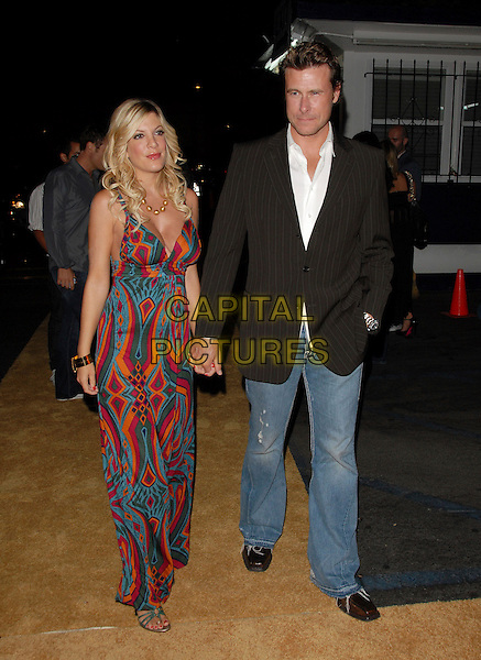 "TORI SPELLING & DEAN McDERMOTT.Mark Burnett & AOL's Launch of ""Gold Rush"" interactive reality competition held at Les Deux in Hollywood, California, USA..September 12th, 2006.Ref: DVS.full length couple married husband wife holding hands jeans denim black pinstripe suit jacket fuschia blue turquoise mulitcoloured pattern dress purple orange blue .www.capitalpictures.com.sales@capitalpictures.com.©Debbie VanStory/Capital Pictures"