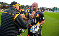 Firebirds coach Bruce Edgar congratulates Luke Woodcock after the McDonalds Super Smash Twenty20 cricket semifinal match between the Wellington Firebirds and Canterbury Kings at the Hawkins Basin Reserve in Wellington, New Zealand on Thursday, 5 January 2017. Photo: Dave Lintott / lintottphoto.co.nz
