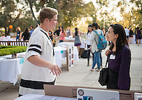 Occidental College student Katherine Torrey '17 shares her InternLA experience working at Machine Project with Elena Aragón with the Office of the Consulate General of Mexico in Los Angeles during the Career Development Center's Reverse Career Fair, Thorne Hall patio, Sept. 3, 2015.<br /> (Photo by Marc Campos, Occidental College Photographer)