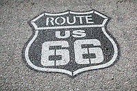 Route 66 highway shield painted on the road.