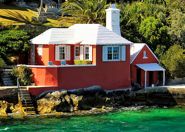 Pink boathouse on the waters of Hamilton, Bermuda