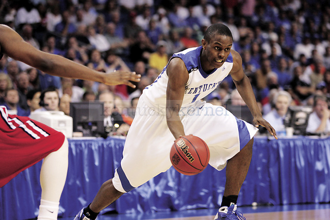 Darius Miller drives the ball during the first game of the SEC Tournament. UK faced off with Ole Miss, who they defeated 71-58. Photo by Brad Luttrell | Staff...
