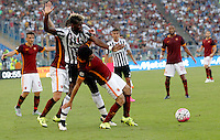 Calcio, Serie A: Roma vs Juventus. Roma, stadio Olimpico, 30 agosto 2015.<br /> Juventus&rsquo; Paul Pogba, left, and Roma&rsquo;s Mohamed Salah fight for the ball during the Italian Serie A football match between Roma and Juventus at Rome's Olympic stadium, 30 August 2015.<br /> UPDATE IMAGES PRESS/Riccardo De Luca