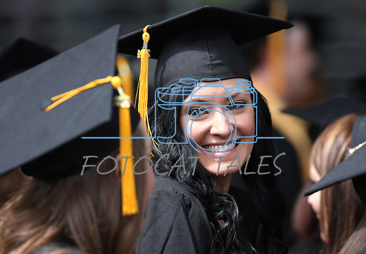 Sarah Jardine talks with friends before the Western Nevada College commencement at the Pony Express Pavilion, in Carson City, Nev., on Monday, May 19, 2014. A record-high 543 students graduate from WNC this week. <br /> Photo by Cathleen Allison/Nevada Photo Source