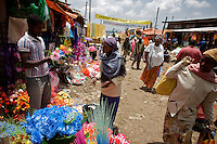 A woman buys artificial plastic flowers at the Shola Market  on the last day of the year 2000 marked on the Gregorian Calender followed in Ethiopia. The image was taken on Wednesday September 10 2008 in Ethiopia's capital Addis Ababa..the Gregorian Calender marks 13 months starting on September 11 of the western calendar. In the year 2007 Ethiopians celebrated their Millennium. Currently the country struggles with two digit inflation, food commodities more than doubled in price in the last year and millions of Ethiopians depending on food aid.