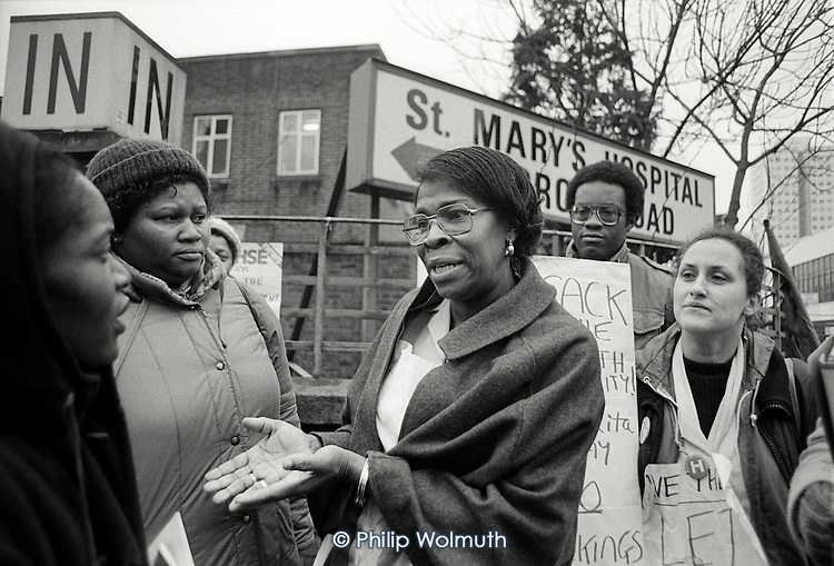 Hospital domestic Rita Maxim speaks outside St Mary's Hospital, Harrow Road, where she has worked for 22 years, after being sacked for refusing to sign a new short term contract.