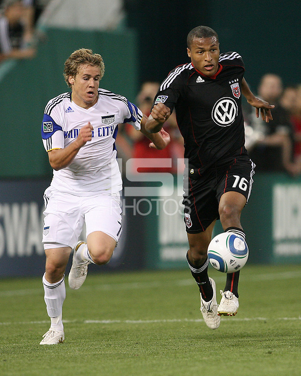 Jordan Graye #16 of D.C.United races for the ball with Chance Myers #7 of the Kansas City Wizards during an MLS match at RFK Stadium on May 5 2010, in Washington DC. United won 2-1