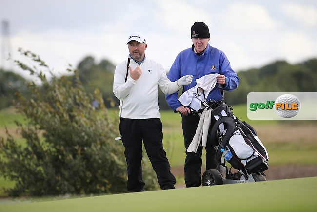 Damien McGrane (IRL) with caddie Keiran Walsh (Headfirst GC President) during the final round of  The 106th Irish PGA Championship, at the Moy Valley Hotel & Golf Resort, Kildare, Ireland.  25/09/2016. Picture: David Lloyd | Golffile.