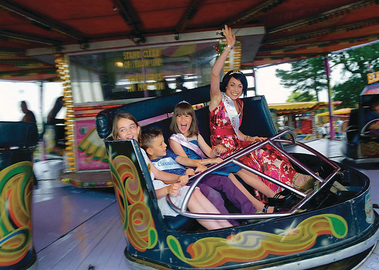 Rose Queen of Attleborough, Ashlee Mead accompanied by<br /> Princess Amy Tebble and Prince Louis Thorpe.<br /> <br /> &quot;The Queen and her court shall be entitled to free<br /> rides on the funfair on the day of the carnival.&quot;