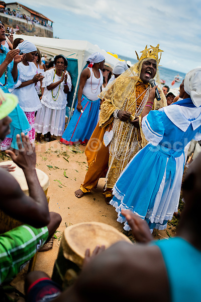 A Candomblé priest (babalorishá) sings during the ritual ceremony in honor to Yemanjá, the goddess of the sea, in Salvador, Bahia, Brazil, 2 February 2012. Yemanjá, originally from the ancient Yoruba mythology, is one of the most popular ?orixás?, the deities from the Afro-Brazilian religion of Candomblé. Every year on February 2nd, thousands of Yemanjá devotees participate in a colorful celebration in her honor. Faithful, usually dressed in the traditional white, gather on the beach at dawn to leave offerings for their goddess. Gifts for Yemanjá include flowers, perfumes or jewelry. Dancing in the circle and singing ancestral Yoruba prayers, sometimes the followers enter into a trance and become possessed by the spirits. Although Yemanjá is widely worshipped throughout Latin America, including south of Brazil, Uruguay, Cuba or Haiti, the most popular cult is maintained in Bahia, Brazil.