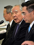 May 9, 2013, Tokyo, Japan - Chairman Osamu Suzuki, center, of Suzuki Motor Corp. announces fourth quarter earnings for the year ended March 2013 during a news conference in Tokyo on Thursday, May 9, 2013. Helped by record vehicle sales at home and in Asia, Japan's No. 4 automaker Suzuki booked a record 80.4 billion yen in net profit, up 49.2 percent year-on-year.  (Photo by Natsuki Sakai/AFLO)..