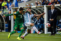 Seattle, WA - Tuesday June 14, 2016: Bolivia defender Erwin Saavedra (2) and Argentina forward Ezequiel Lavezzi (22) clash for the ball during a Copa America Centenario Group D match between Argentina (ARG) and Bolivia (BOL) at CenturyLink Field