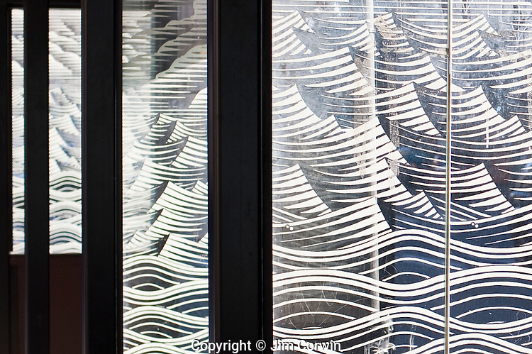 Design patterns waves on a bus stop shelter windows downtown Seattle, Washington State