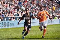 Danny Cruz (44) of the Philadelphia Union and Jermaine Taylor (4) of the Houston Dynamo. The Philadelphia Union defeated the Houston Dynamo 3-1 during a Major League Soccer (MLS) match at PPL Park in Chester, PA, on September 23, 2012.