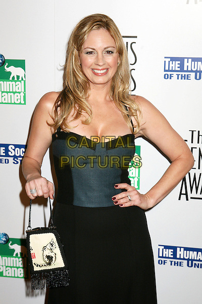 ANNEMARIE LUCAS.20th Anniversary Genesis Awards presented by  US Humane Society, Beverly Hills, California, USA..March 18th, 2006.Photo: Byron Purvis/AdMedia/Capital Pictures.Ref: BP/ADM.half length black green top bag purse nail polish varnish.www.capitalpictures.com.sales@capitalpictures.com.© Capital Pictures.