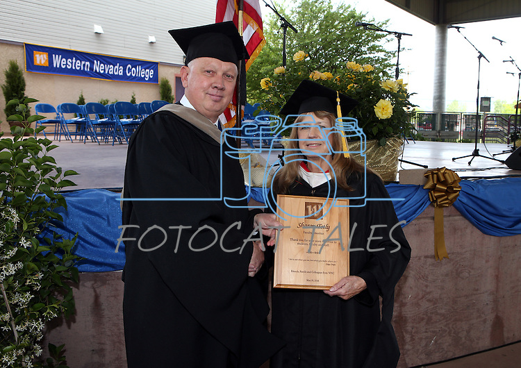 Interim President Chester Burton recognizes Faculty Emeriti recipient Sharon Tetly before the Western Nevada College commencement at the Pony Express Pavilion, in Carson City, Nev., on Monday, May 19, 2014. <br /> Photo by Cathleen Allison/Nevada Photo Source