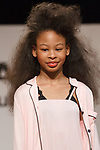 Model walks runway in an outfit from the Katie J collection during the petitePARADE fashion show at Children's Club in the Jacob Javits Center in New York City on February 25, 2018.