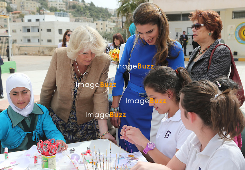 CAMIILLA, DUCHESS OF CORNWALL AND QUEEN RANIA.visit Mahes Secondary School for Girls, Amman_12/03/2013.The Royal couple are on a tour of four Middle Eastern countries.