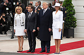 United States President Donald J. Trump stands with first lady of the United States Melania Trump, French President Emmanuel Macron, and first lady of France Brigette Macron  on the South Lawn of the White House during the French State Visit to the United States on April 24, 2018 in Washington, DC. Credit: Alex Edelman / Pool via CNP