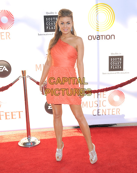 Carmen Electra.attends the Dizzy Feet Foundation's Celebration of Dance Gala held at The Dorothy Chandler Pavilion at The Music Center in Los Angeles, California, USA,  July 28th 2012..full length orange dress one shoulder gold silver shiny peep toe christian loubouin shoes shooboots platform                                                               .CAP/RKE/DVS.©DVS/RockinExposures/Capital Pictures.