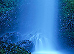 Latourell Falls creates a misty blanket of water on a boulder in the Columbia Gorge Scenic Area, Oregon.