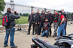 LONDON, ENGLAND, 22 May ,2014.  Bikers have a photograph taken after theu arrive at Woolwich Barracks to mark the first anniversary of the murder of Fusilier Lee Rigby  near his Woolwich barracks.