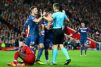 Crvena Zvezda's Filip Stojkovic and team-mates protest to Referee Daniel Siebert after he awarded a penalty to Liverpool<br /> <br /> Photographer Richard Martin-Roberts/CameraSport<br /> <br /> UEFA Champions League Group C - Liverpool v Crvena Zvezda - Wednesday 24th October 2018 - Anfield - Liverpool<br />  <br /> World Copyright © 2018 CameraSport. All rights reserved. 43 Linden Ave. Countesthorpe. Leicester. England. LE8 5PG - Tel: +44 (0) 116 277 4147 - admin@camerasport.com - www.camerasport.com