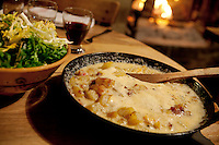Tartiflette prepared by chef Albert Bonamy at restaurant La Ferme de Lormay, Le Grand Bornand, France, 15 February 2012. Tartiflette, containing potatoes, bacon and reblochon cheese, is a traditional dish of the French Alps.