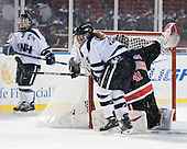 Kelly Cahill (UNH - 4), Florence Schelling (NU - 41) - The University of New Hampshire Wildcats defeated the Northeastern University Huskies 5-3 (EN) on Friday, January 8, 2010, at Fenway Park in Boston, Massachusetts as part of the Sun Life Frozen Fenway doubleheader.