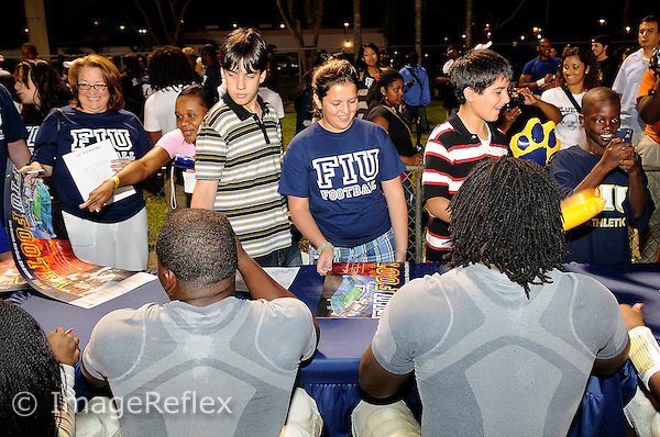 18 April 2008:  Florida International football players sign autographs for fans after the FIU Spring Game at the University Park Soccer Field in Miami, Florida.