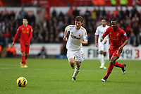 Sunday, 25 November 2012<br /> Pictured L-R: Ben Davies of Swansea marked Raheem Sterling of Liverpool<br /> Re: Barclays Premier League, Swansea City FC v Liverpool at the Liberty Stadium, south Wales.