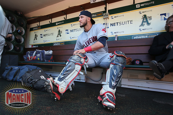 OAKLAND, CA - APRIL 2:  Yan Gomes #10 of the Cleveland Indians gets ready in the dugout before the game against the Oakland Athletics at O.co Coliseum on Wednesday, April 2, 2014 in Oakland, California. Photo by Brad Mangin