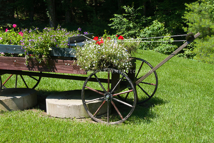 Lovely Farm Cart Flower Container Garden Using Rustic Wheeled Old Antique Tractor  For Garden Ornament