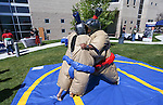 Joao Vitor De Oliveira and Rodrego Pimenta sumo wrestle during a student BBQ and club fair at Western Nevada College in Carson City, Nev., on Thursday, Sept. 1, 2016. <br />Photo by Cathleen Allison