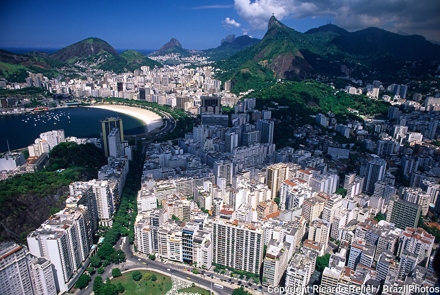 Aerial view of part of Rio de Janeiro south zone - Flamengo quarter in foreground linked to the Enseada de Botafogo ( Botafogo Cove or Botafogo beach ) in the middle by the tree lined Osvaldo Cruz avenue and Christ the Redeemer & the Tijuca Forest in background, Brazil.