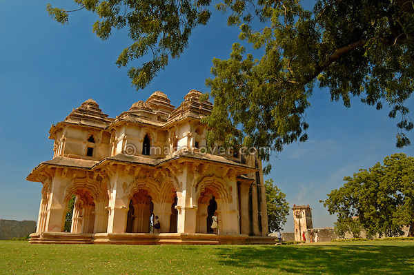 The two storeyed Lotus Mahal with recessed archways is one of the major attractions within the World Heritage Site of Hampi. The architecture is a skilful mixture under Hindu and Islamic influence. The pillars, the arches and the windows are of Islamic character, while the Sikharas or spires are Hindu. India, Karnataka, Hampi.