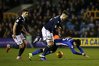 Jake Cooper of Millwall fouls Sheffield Wednesday's Fernando Forestieri during Millwall vs Sheffield Wednesday, Sky Bet EFL Championship Football at The Den on 12th February 2019