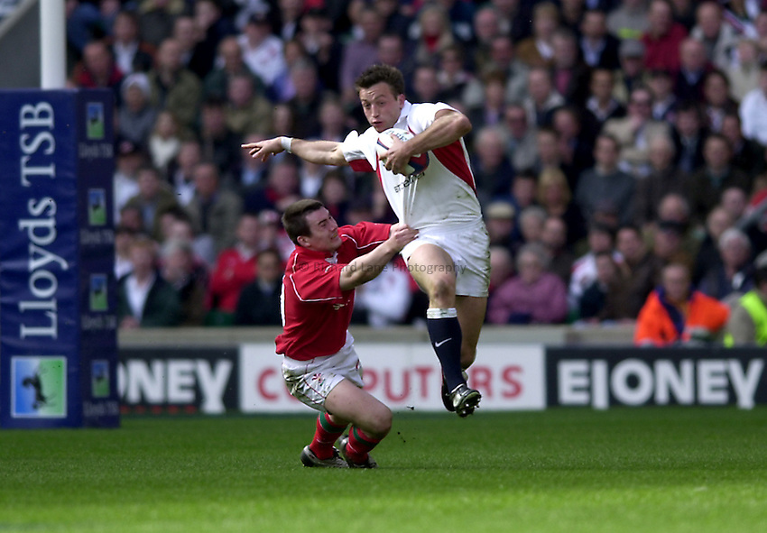 Photo. Richard Lane.Lloyds TSB Six Nations Championship. England v Wales at Twickenham. 23-3-2002.Dan Luger breaks the tackle of Iestyn Harris.